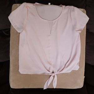 Light pink blouse, v opening in neck, tie front